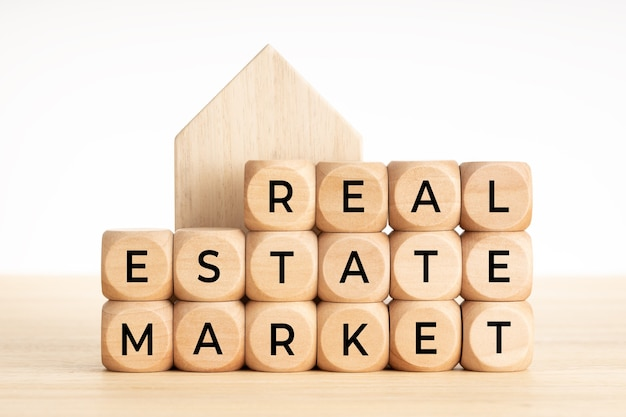Real estate market concept. wooden blocks with text and house icon. copy space.
