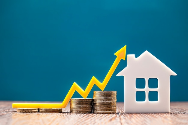 Real estate market, graph, up arrow. house model and a stack of coins. the concept of inflation, economic growth, the price of insurance services. copy space
