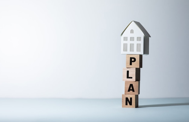 Real estate or property concepts with plan text and model house.business investment and financial.