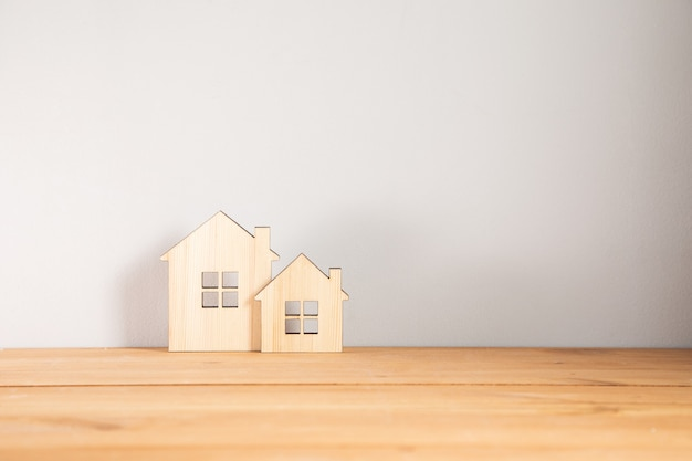 Real estate, wooden house models on table
