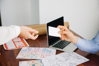 Real estate workers with business card