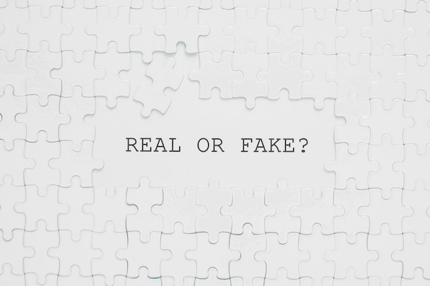 Real or fake quote in white puzzle pieces