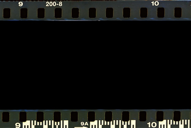 Real film border strip scan and old texture frame and isolated black space.