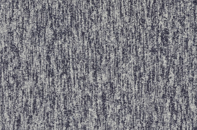 Real heather knitted fabric made of synthetic fibres textured background.