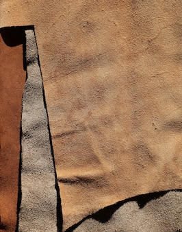 Real leather piece brown fabric background