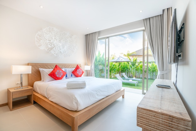 Real luxury interior design in bedroom of pool villa with cozy king bed with high raised ceiling home, house ,building