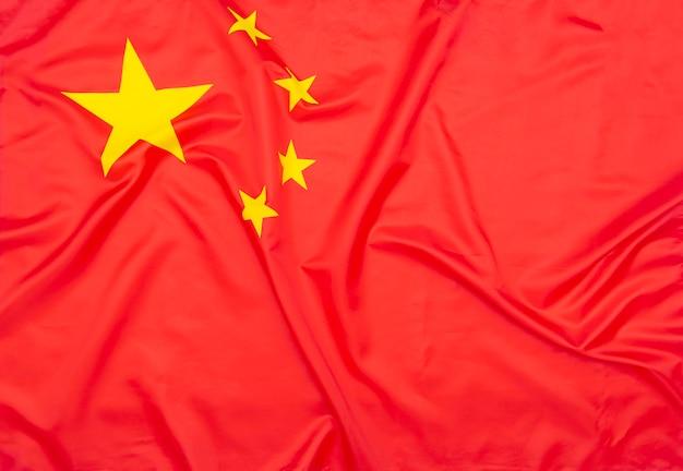 テクスチャまたは背景としての中国の本物の天然素材の旗または中華人民共和国の国旗