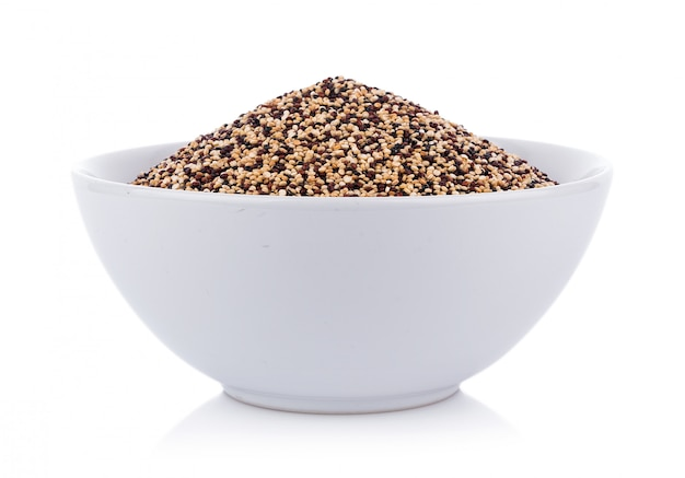Real quinoa seeds in a bowl isolated on white