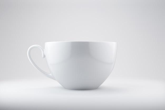 손잡이와 현실적인 빈 커피 또는 차 머그 컵 프리미엄 사진