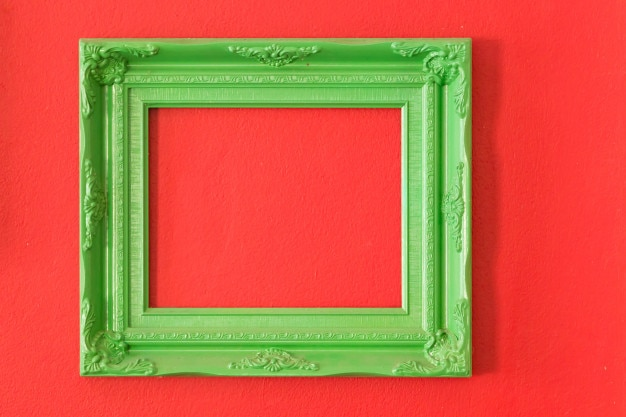 Realistic blue picture frames on red cement background.