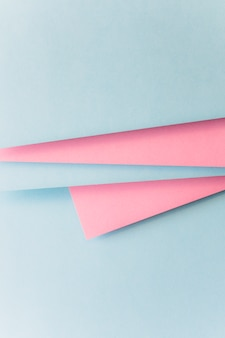 Realistic blue and pink paper background