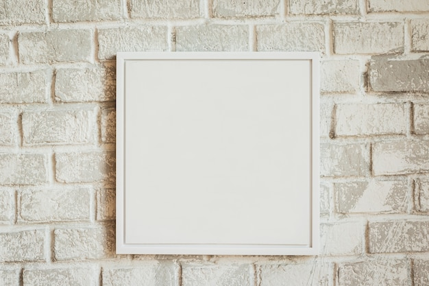 Realistic empty  white frame on light background, border for your creative project.
