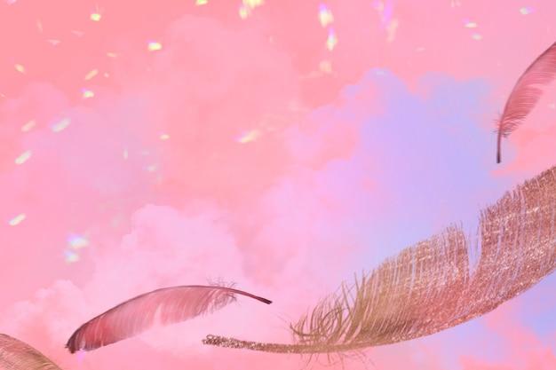 Piuma realistica su sfondo rosa