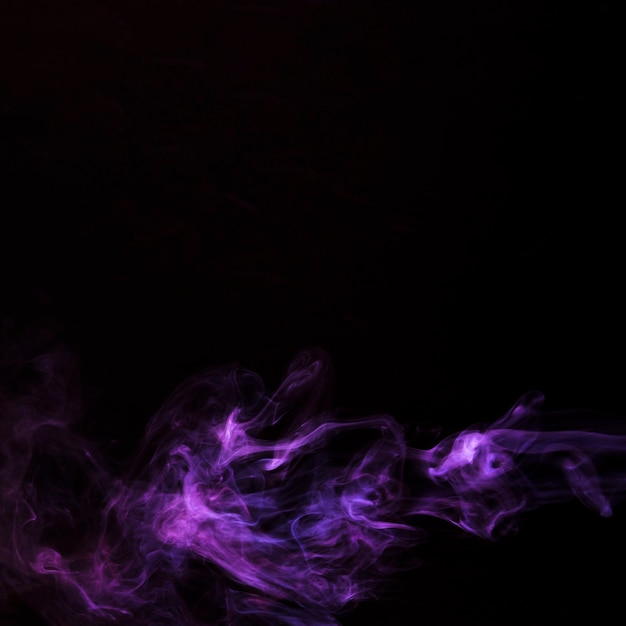 Realistic purple smoke waves isolated on black background