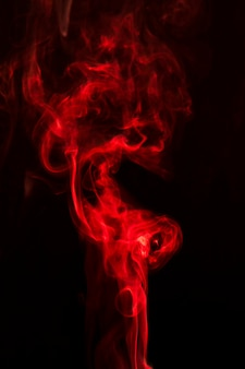 Realistic red smoke on black background