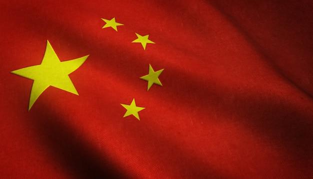 興味深いテクスチャを持つ中国の旗を振っているのリアルなショット