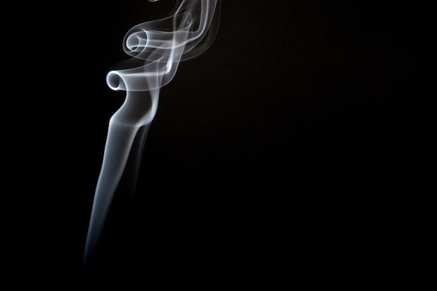 Realistic shot of a wisp of smoke against a black background