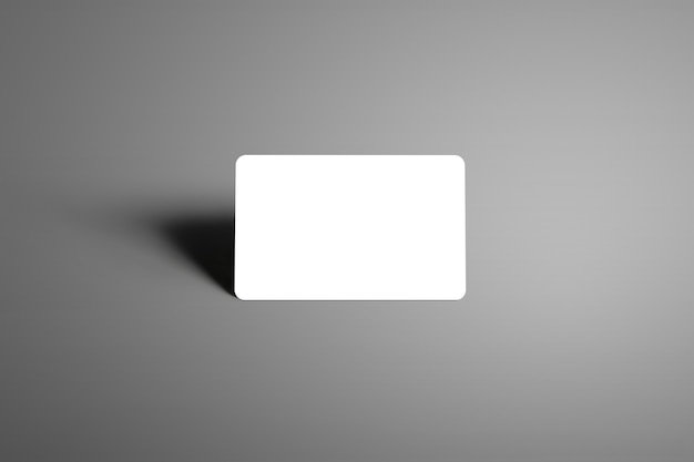 Realistic white bank gift card standing on the corner with shadows isolated background. ready to used in your showcase.