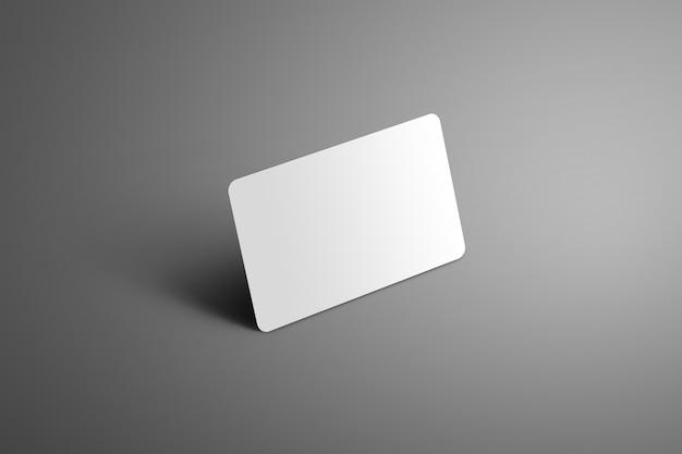 影が孤立した背景と角に立っているリアルな白い銀行のギフトカード。ショーケースで使用する準備ができました。