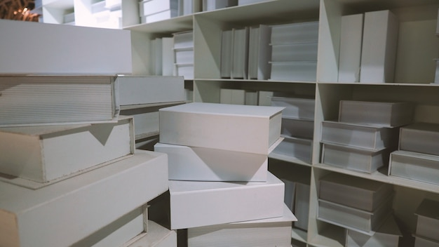 Realistic white color book shelf stack mock up for decoration in reading room which every book
