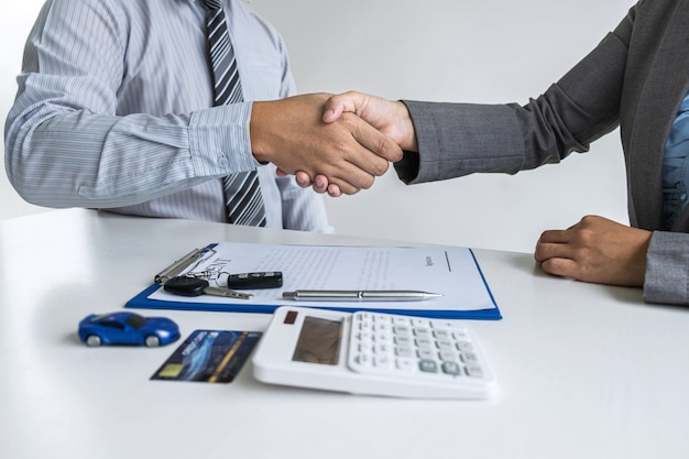 Realtor agent manager shaking hands with a client