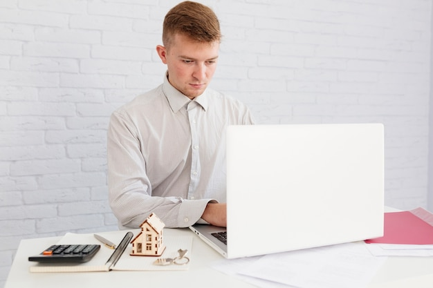 Realtor using laptop at workplace