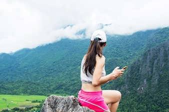 Rear hiking woman on top mountain with nature view (Namxay Top View at Laos).