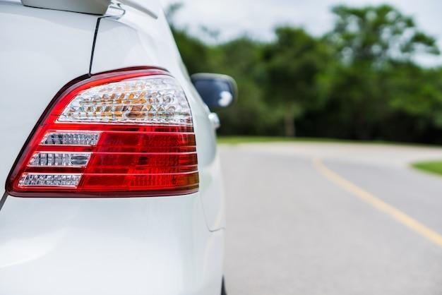 Rear lights of a car on the asphalt road