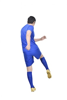 Rear view of asian footballer man shooting the ball