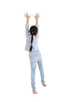 Rear view asian little kid girl climbing expression isolated on white