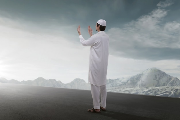 Rear view of asian muslim man praying