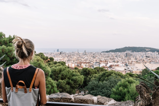 Rear view of a blond woman looking at barcelona city view