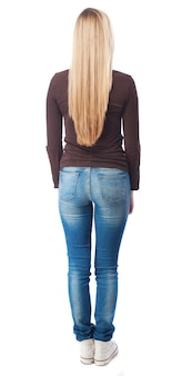 Rear view of blonde teen in jeans