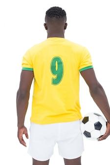Rear view of brazilian football player