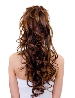 Rear view of a bride with  curly wedding hairstyle  isolated on white