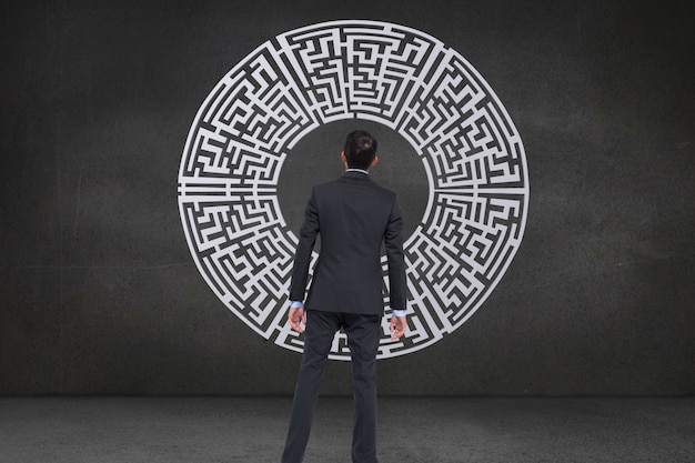 Rear view of businessman looking a maze