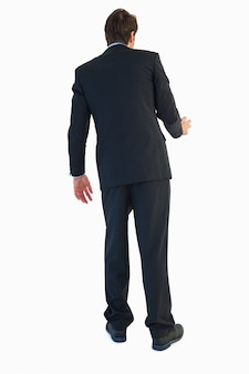Rear view of businessman opening a door