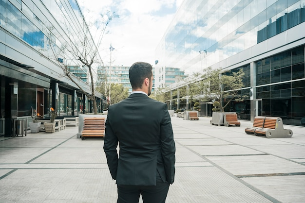 Rear view of a businessman standing on the business campus