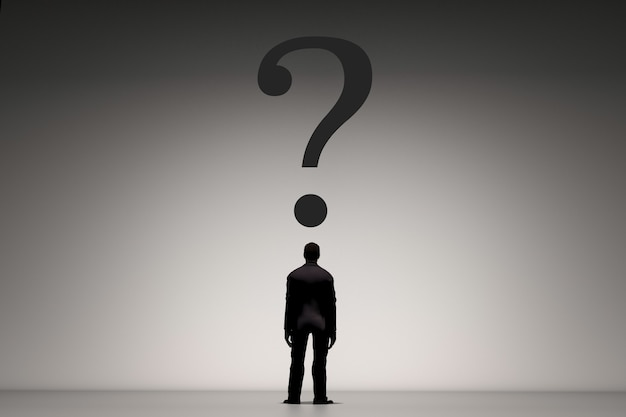 Rear view of businessman standing with question mark