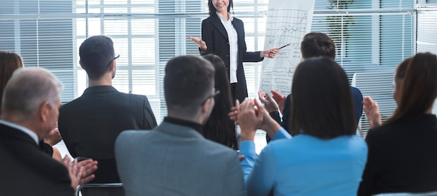 Rear view. businesswoman making a presentation for the employees of the company
