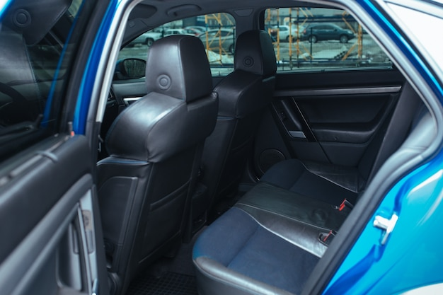 Rear view of the car interior with the door open