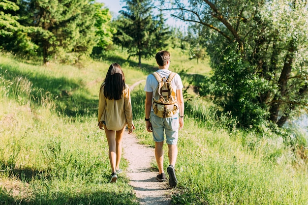 Rear view of couple hiking together at outdoors