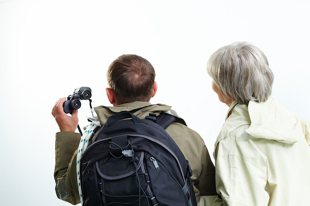 Rear view of couple with binoculars