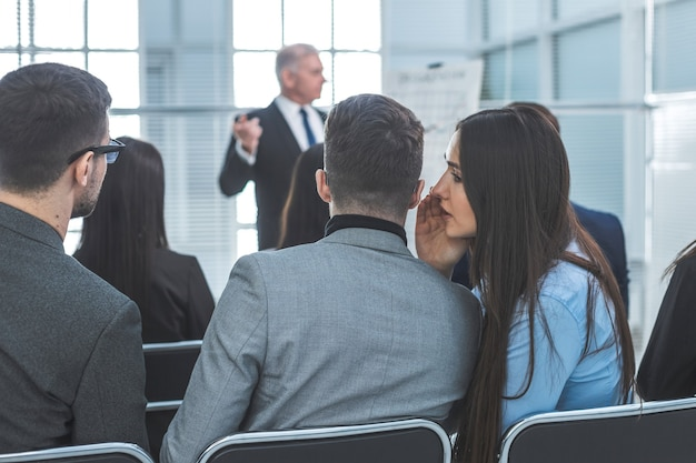 Rear view. employees discuss something during a business seminar