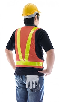 Rear view of male construction worker with standard construction safety equipment isolated