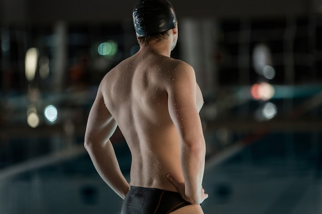 Rear view of a male swimmer