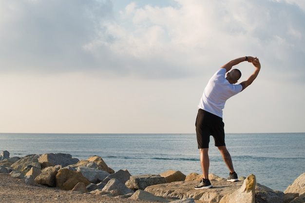 Rear view of man doing low-intensity warm-up