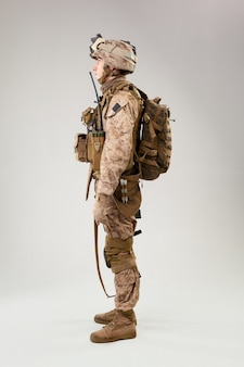 Rear view of military soldier us army marines operator studio shot portrait