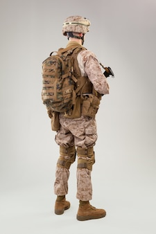Rear view of military soldier us army marines operator