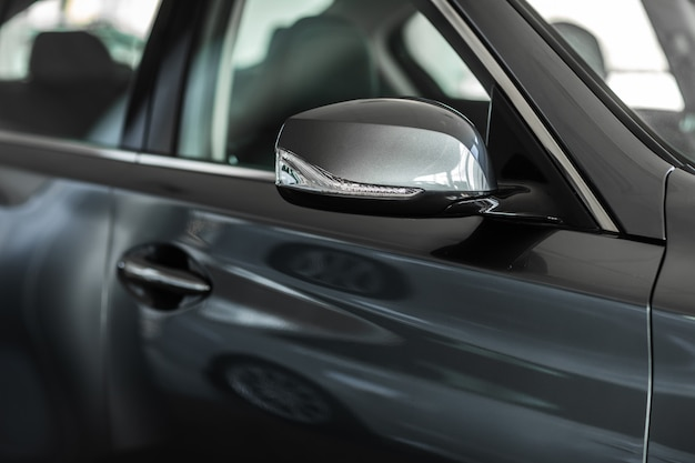 Rear view mirror. focus to mirror view. side rear-view mirror on a car.